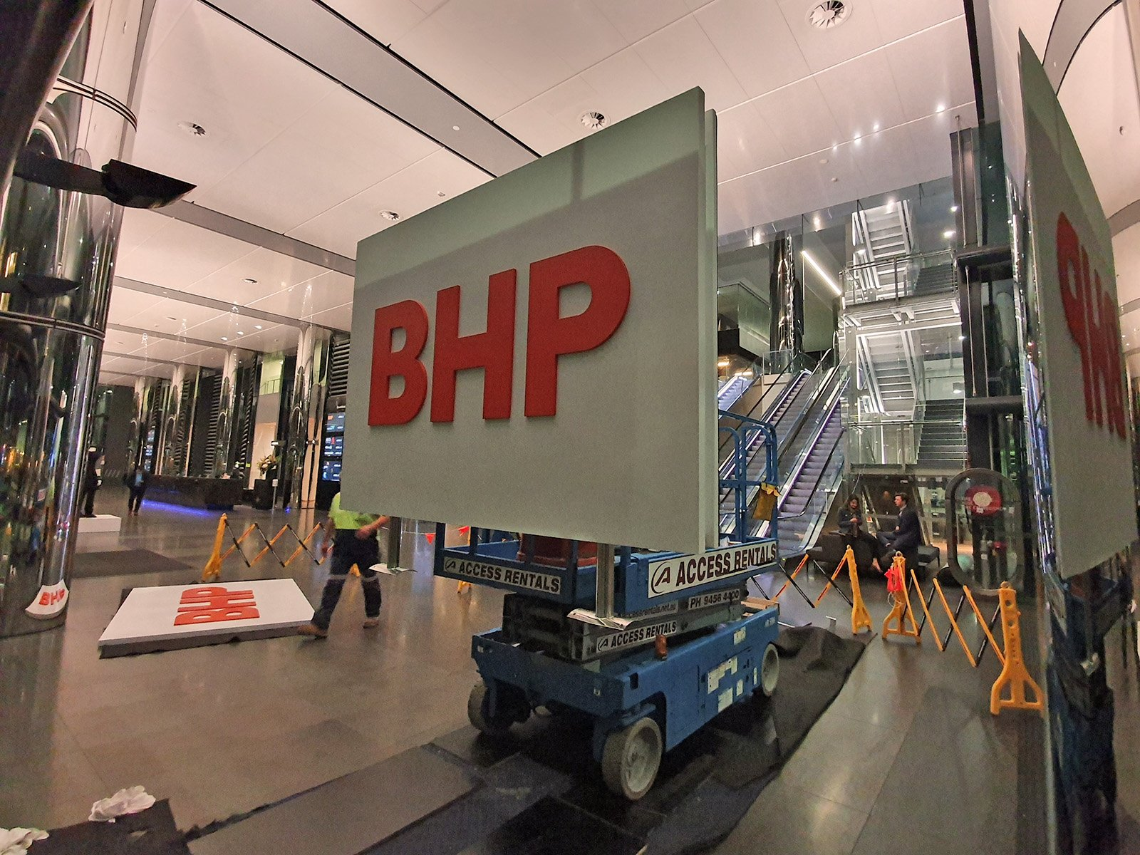 BHP re-branding double sided illuminated LED sign on the scissor lift